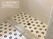 Flower mosaic tiles installed by District Flooring & Restoration